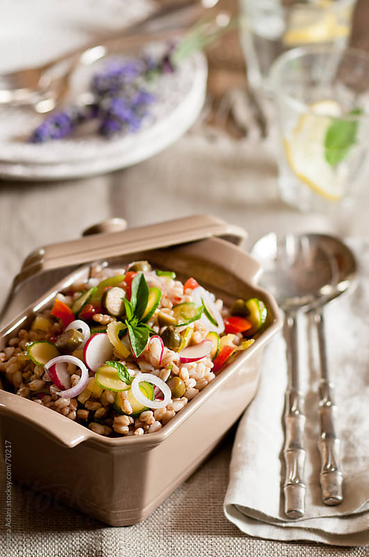 spelt salad with fresh vegetables by Laura Adani for Stocksy United