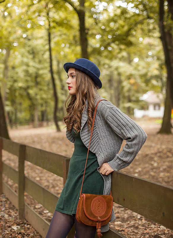 Young Woman Standing in the Park by Mosuno for Stocksy United