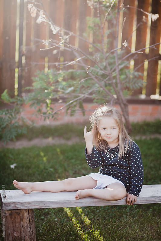 Little girl sitting on the bench  by Irina Efremova for Stocksy United