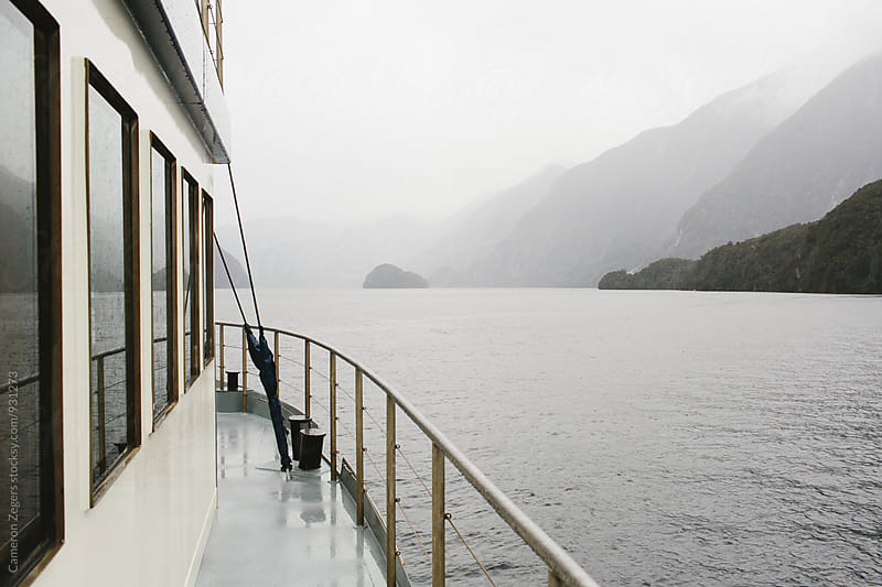 passenger boat in Doubtful Sound, New Zealand by Cameron Zegers for Stocksy United