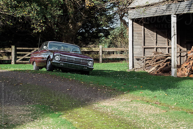 Vintage car parked at farm homestead by Rowena Naylor for Stocksy United