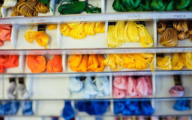 Different colors of yarn by Carolyn Lagattuta for Stocksy United