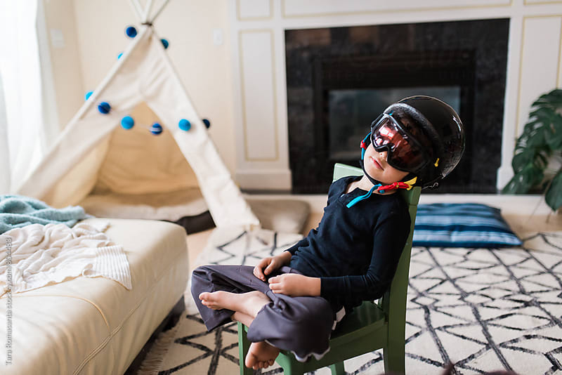 young boy wearing goggles and a helmet by Tara Romasanta for Stocksy United