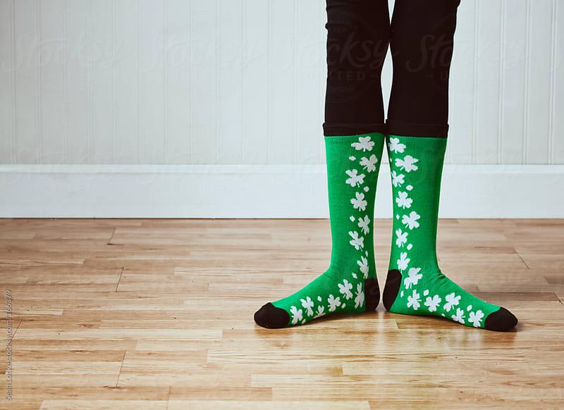 Green: Anonymous Legs Wearing Shamrock Socks by Sean Locke for Stocksy United