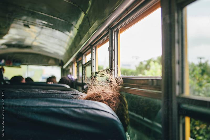 Child sleeping in school bus by Stephen Morris for Stocksy United