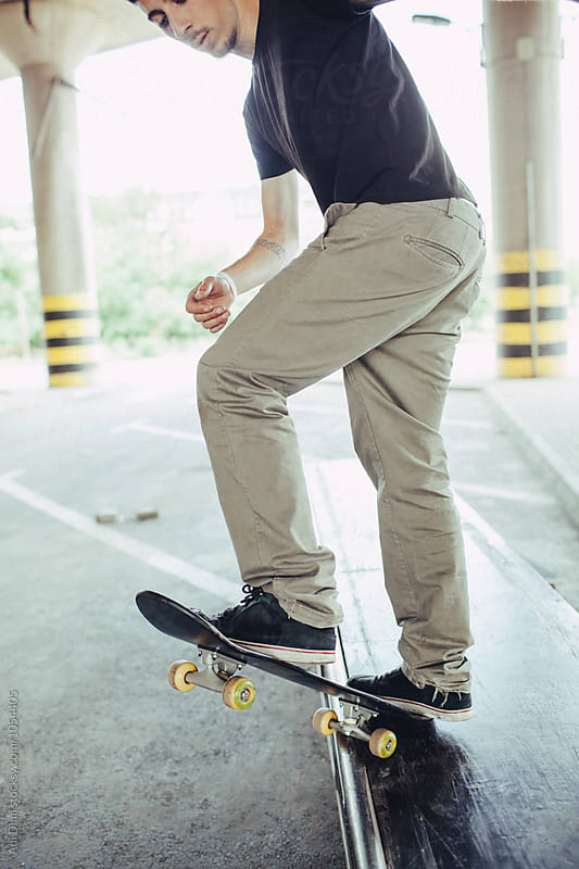 Skater performing a skate trick by Ani Dimi for Stocksy United