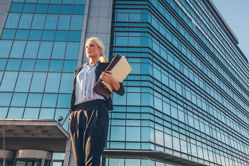 Businesswoman in front of an Office Building by Lumina for Stocksy United