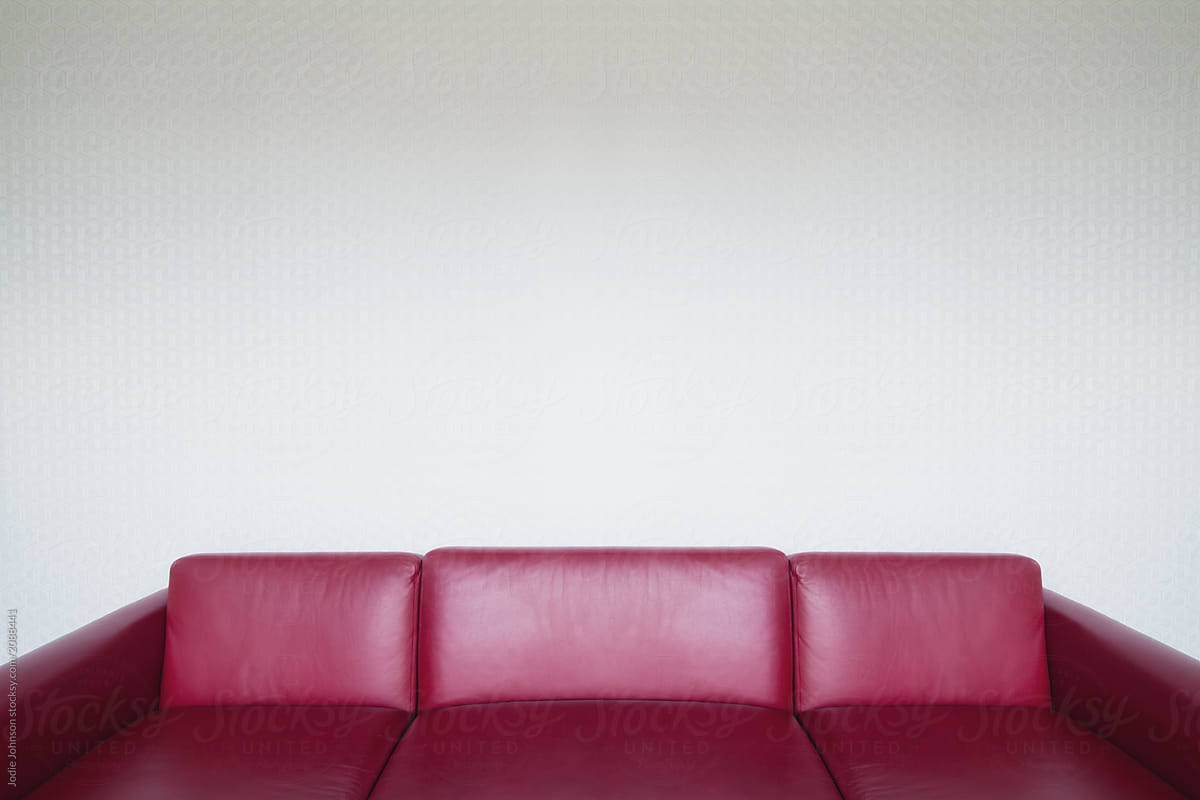 Stock Photo Red Leather Sofa With Geometrical Wallpaper