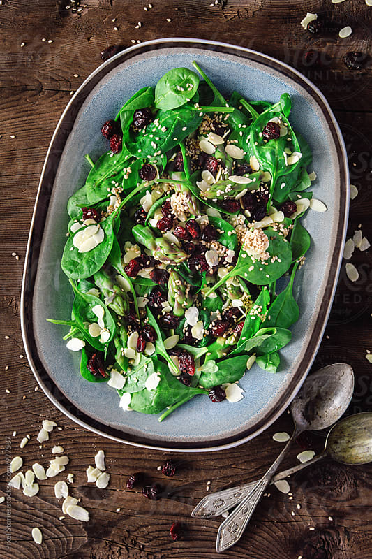 Cranberry almond spinach salad  by Pixel Stories for Stocksy United