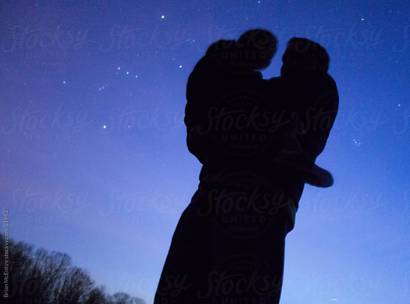 Star Gazing: Father and Son Silhouette with Orion Constellation by Brian McEntire for Stocksy United