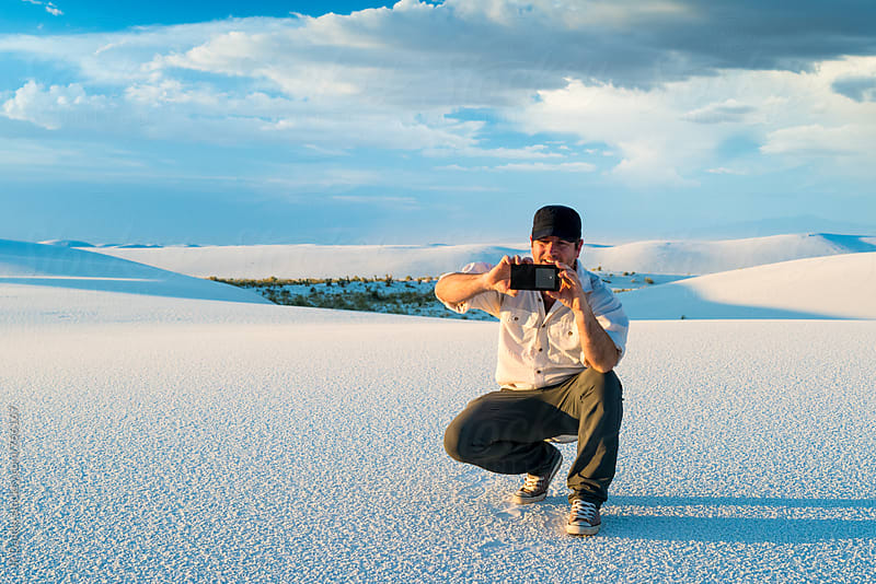 Man Taking Picture WIth Mobile Phone of White Sand Dunes with in White Sands National Monument New Mexico by JP Danko for Stocksy United