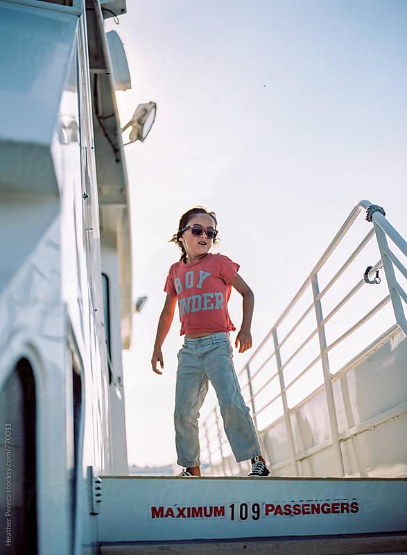 Boy enjoying wind on the ferry by Heather Perera for Stocksy United