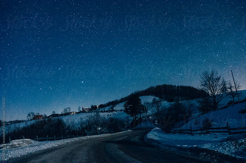Beautiful winter night with a lot stars in the sky by Dimitrije Tanaskovic for Stocksy United