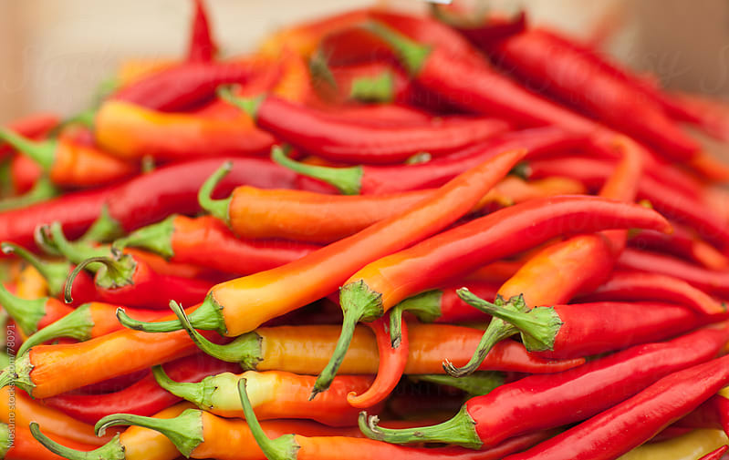 Pile of chillies.  by Mosuno for Stocksy United