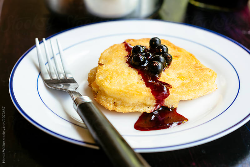 Corn Pancakes with Blackcurrant Sauce by Harald Walker for Stocksy United