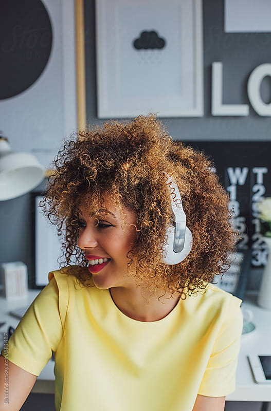 Happy African Woman Listening to Music by Lumina for Stocksy United