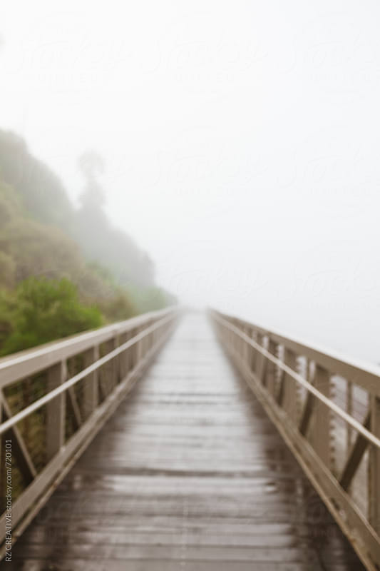 Foot bridge along the coast on a foggy morning,  by Robert Zaleski for Stocksy United