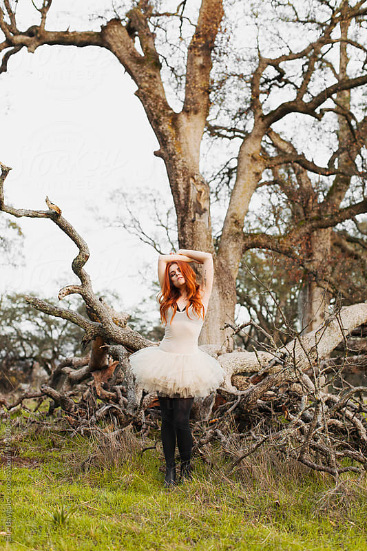 Redhead girl in a park by Ellie Baygulov for Stocksy United