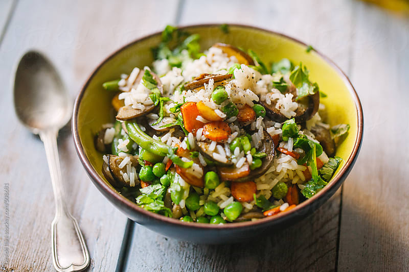 Rice with mixed vegetables by Davide Illini for Stocksy United