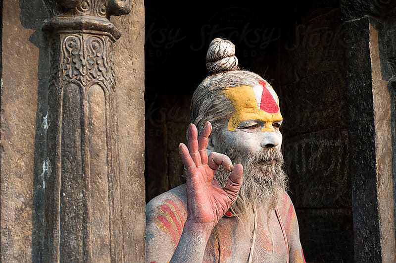 Portrait of a sadhu on a temple by Bisual Studio for Stocksy United