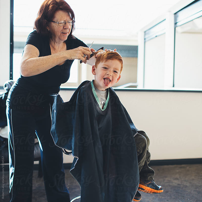 Getting a haircut at home by Robert Lang for Stocksy United