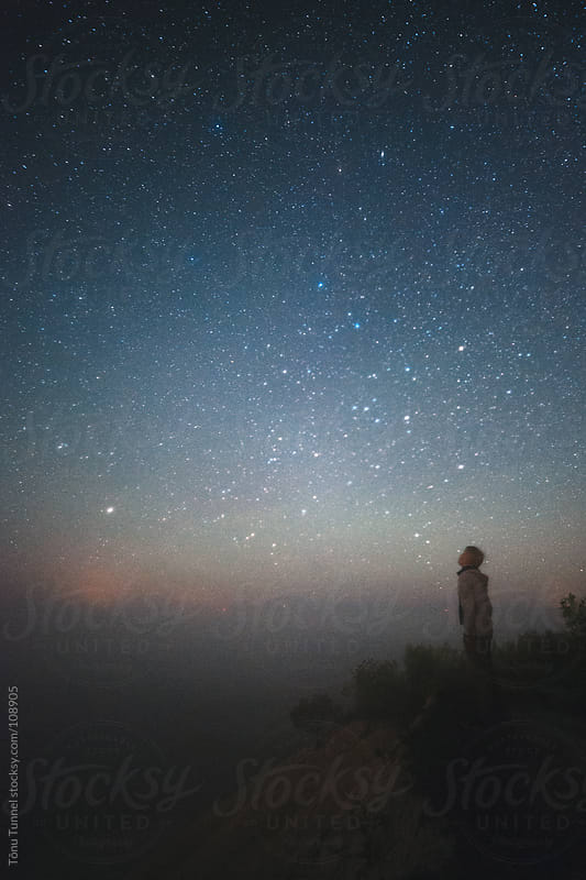 A boy looking at the stars by Tõnu Tunnel for Stocksy United