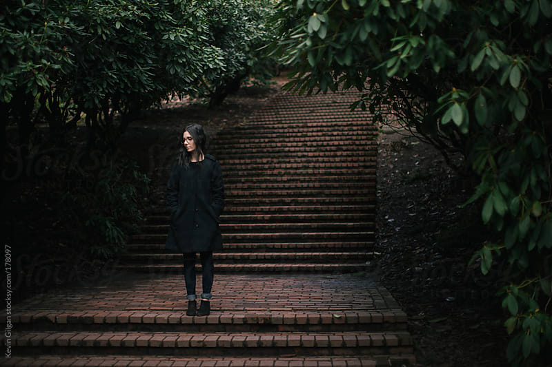 Girl Stands On Forest Steps by Kevin Gilgan for Stocksy United