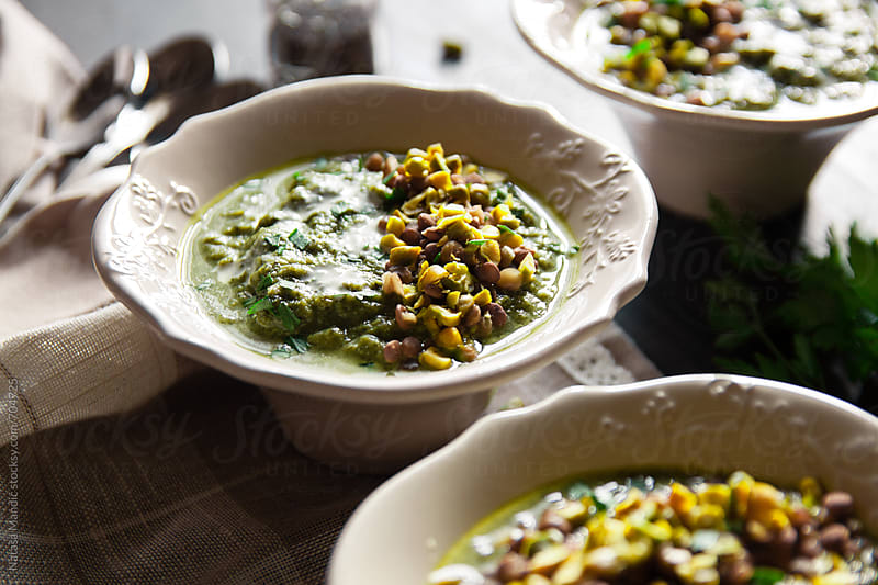 Broccoli, chicory, chard soup with lentils and pistachio nut topping by Nataša Mandić for Stocksy United