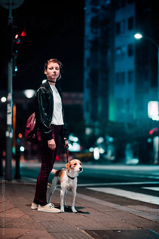 Young stylish woman with her dog by Boris Jovanovic for Stocksy United
