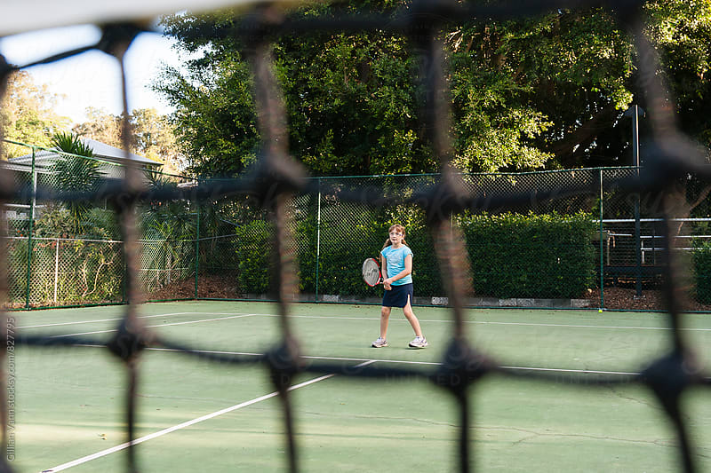 tween girls playing tennis by Gillian Vann for Stocksy United