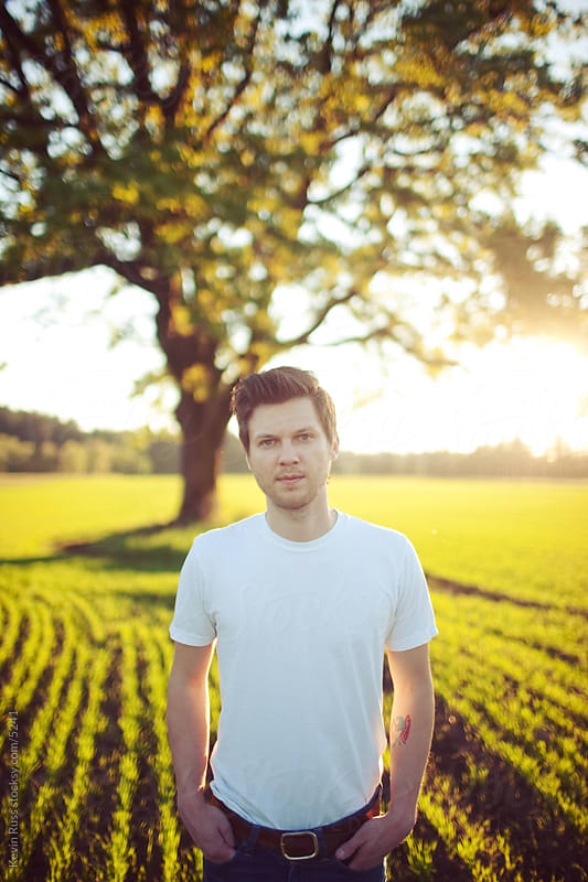 Sunset Tree Field Man by Kevin Russ for Stocksy United