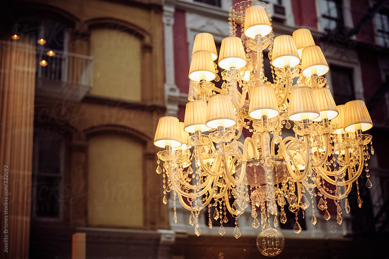 Luxury Chandelier Lighting with Reflections of Buildings by Joselito Briones for Stocksy United