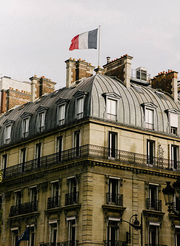 French Flag Flying Over Paris by Benj Haisch for Stocksy United