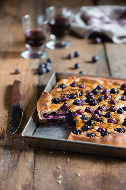 Focaccia filled with black grape by Laura Adani for Stocksy United