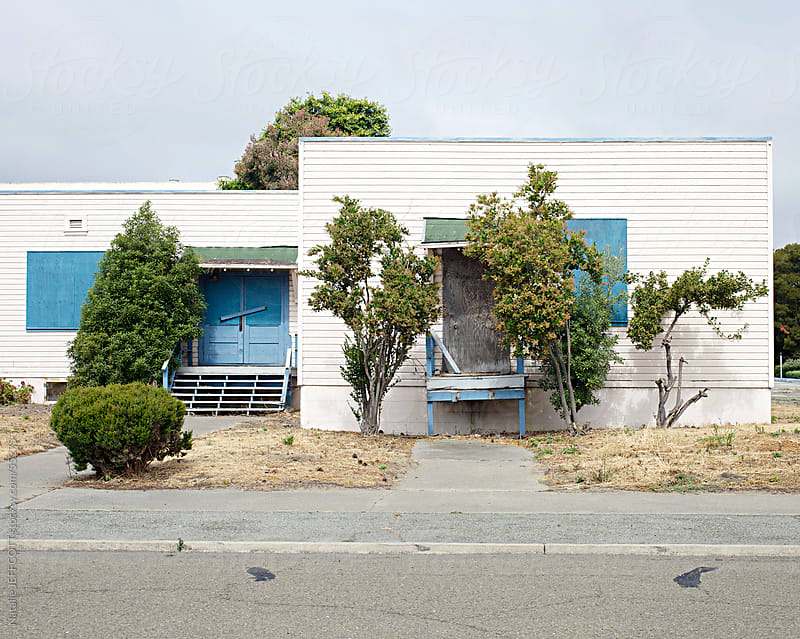 Abandoned old building with trees in Alameda, California by Natalie JEFFCOTT for Stocksy United