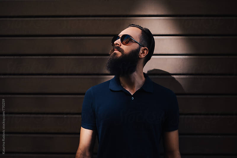 Portrait of a Handsome Bearded Man with a Sunglasses by Katarina Radovic for Stocksy United