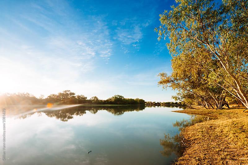 sunrise on a stream in outback Australia, NT by Gillian Vann for Stocksy United