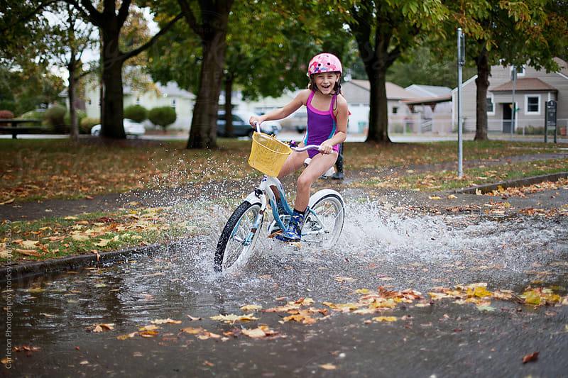 Enjoying the rain on a bike in Portland Oregon by Carleton Photography for Stocksy United