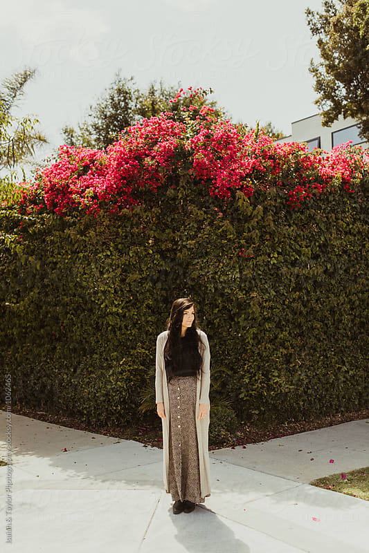 Trendy woman on neighborhood sidewalk by Isaiah & Taylor Photography for Stocksy United