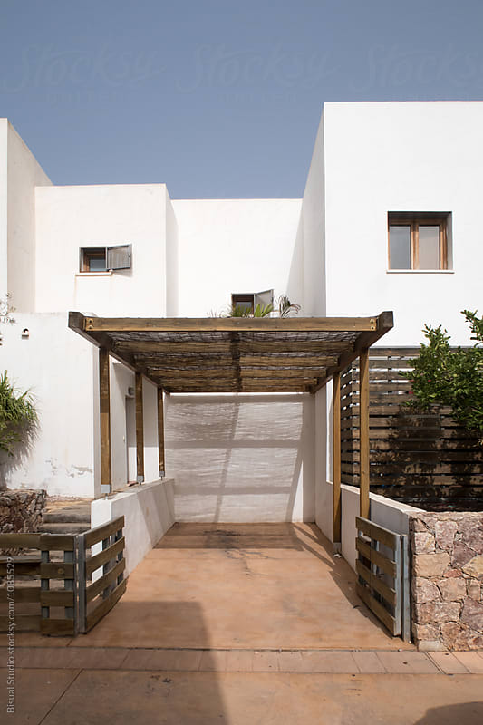 Empty parking lot between touristic apartment buildings in Cabo de Gata by Bisual Studio for Stocksy United