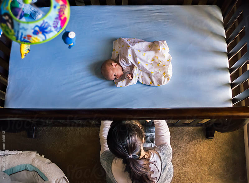 Overhead family portrait - Newborn boy in crib and mother  by yuko hirao for Stocksy United