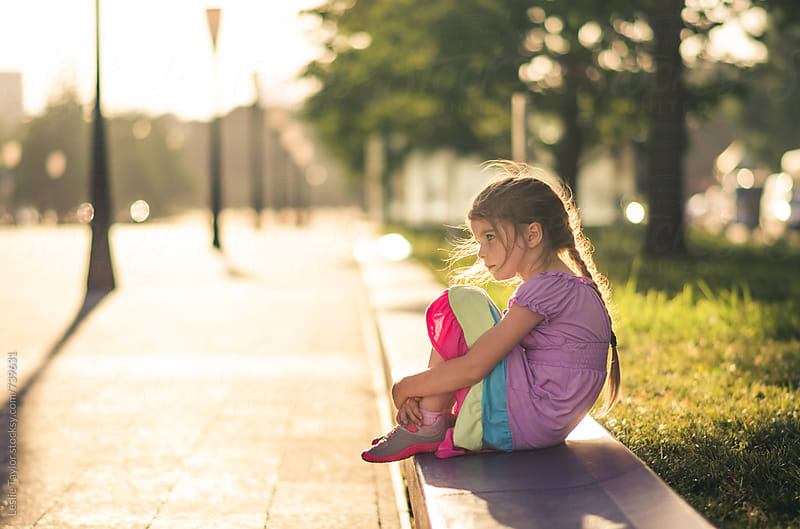 Young Girl Sitting In The City by Leslie Taylor for Stocksy United