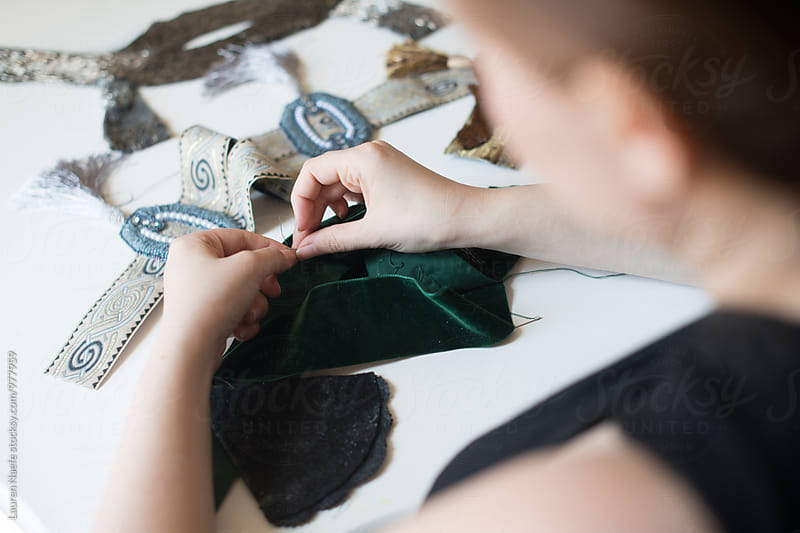 Designer sewing in studio by Lauren Naefe for Stocksy United