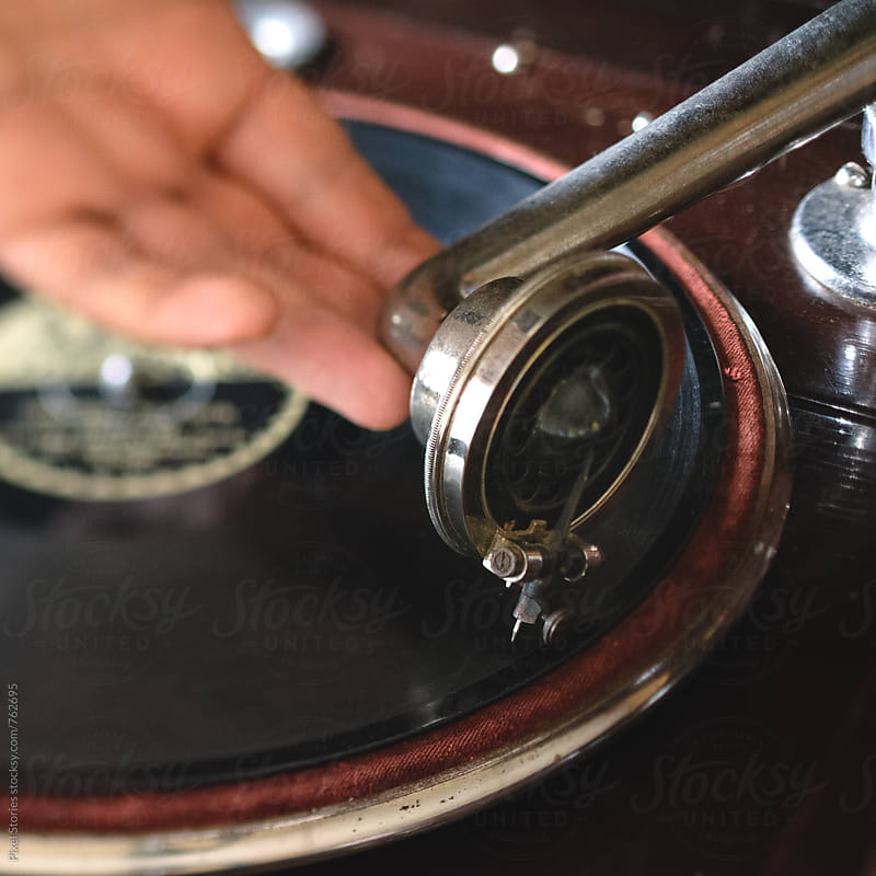 Person placing gramophone soundbox over record by Pixel Stories for Stocksy United