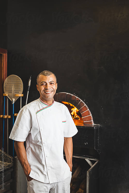 Mixed Race Happy Chef in Italian Pizzeria by Giorgio Magini for Stocksy United