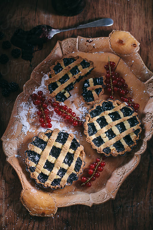 Tarts with blueberries by Davide Illini for Stocksy United