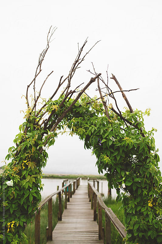 arbor over dock by Nate & Amanda Howard for Stocksy United