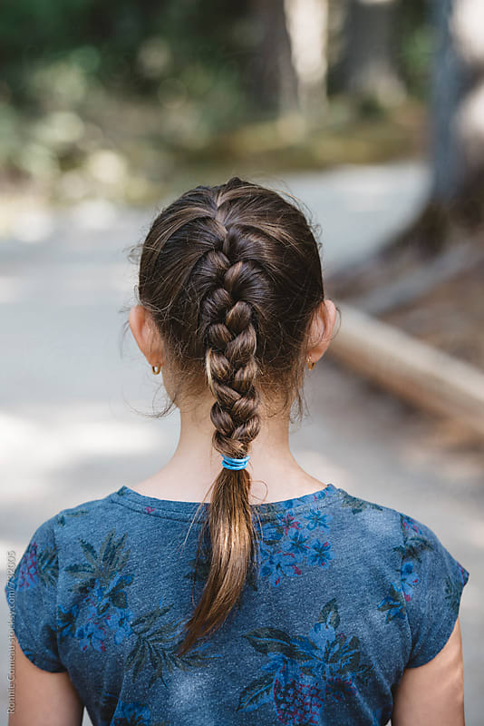 Braided Preteen Girl Outdoors by Ronnie Comeau for Stocksy United