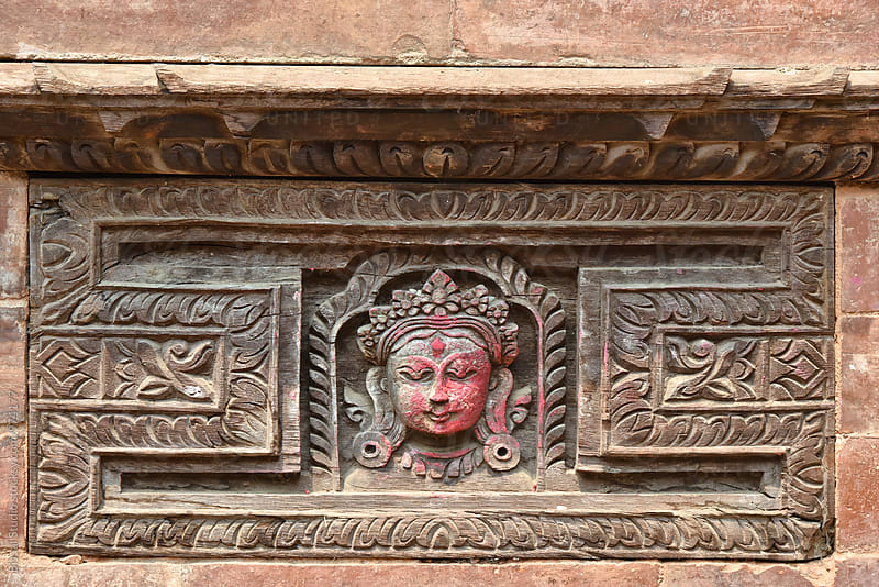 Detail of a face carved on wood in a nepali facade by Bisual Studio for Stocksy United