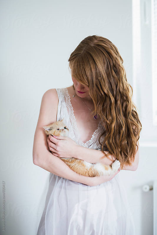 Young woman holding her kitten by Jovana Rikalo for Stocksy United